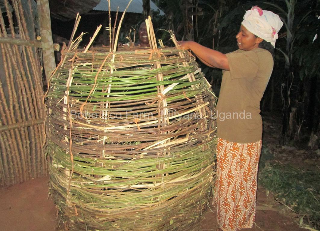 A woman constructing a food granary